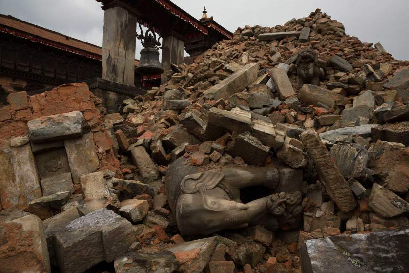 Nepal earthquake. Bhaktapur. A city near Katmandu. People reclaiming their possessions from the wreckage. A man who had been buried and died being pulled out of the wreckage by there Nepali Army rescue team. Sculpture of elephant in ruins  of an ancient, sacred temple.