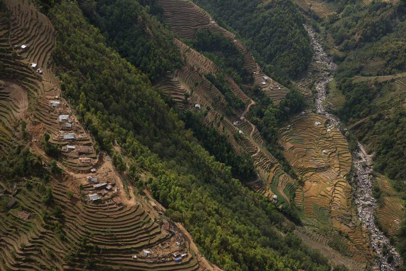 Nepal earthquake. Town of Sankhu. Mush of town was destroyed. People digging out their possessions. Aerial images of Nuwakot district, hit by the earthquake and not able to be reached by aid and rescue teams. Farming villages built atop steep hillsides with cascading, terraced fields. by James Nachtwey