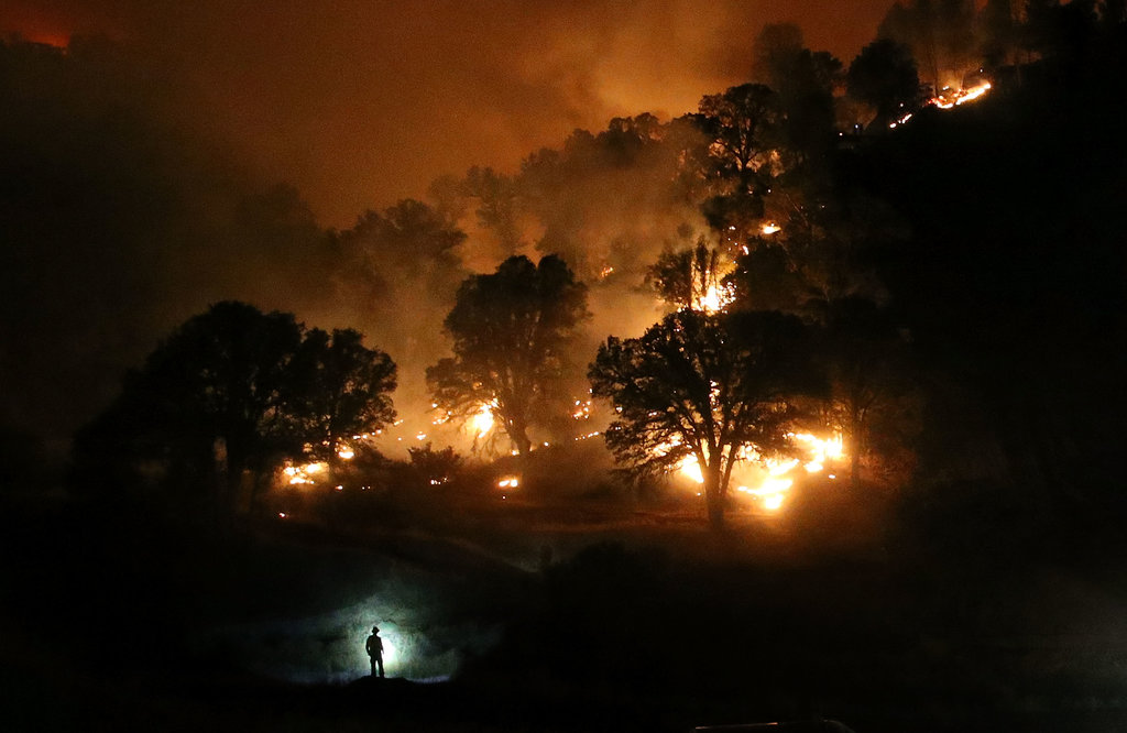 CLEARLAKE, CALIF. 8/3/2015 A firefighter was silhouetted by his headlamp as he battled the Rocky Fire, a wildfire that spread over three counties and burned over 60,000 acres. Justin Sullivan/Getty Images