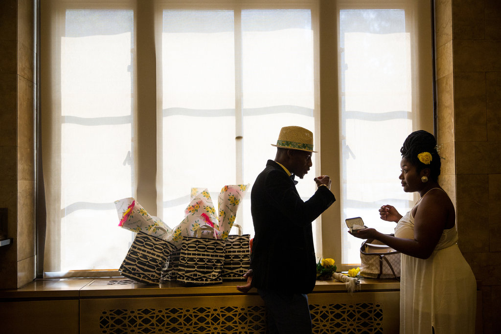MANHATTAN 8/19/2015 Abdoulaye Jallot and his bride, Ioni Maul, at the Manhattan marriage bureau, where there has been a nearly 50 percent increase in ceremonies since 2008. Damon Winter/The New York Times