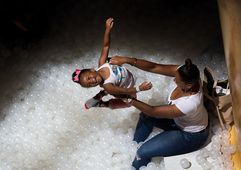 WASHINGTON 8/13/2015 A child frolicked at The Beach, an interactive installation by Snarkitecture at the National Building Museum. Stephen Crowley/The New York Times