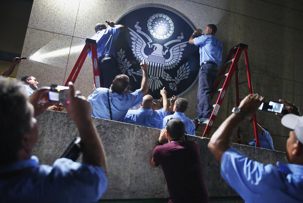 HAVANA 8/14/2015 Workers hanging the seal of the United States at the reopened American Embassy. Chip Somodevilla/Getty Images