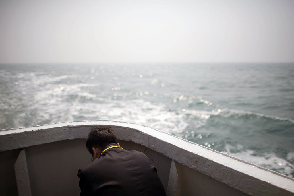 OFF THE COAST OF JINDO, SOUTH KOREA 4/15/2015 A relative of a victim of the Sewol ferry sinking attended the one-year memorial. The sinking killed more than 300 people, most of them teenagers. Pool photo by Ed Jones