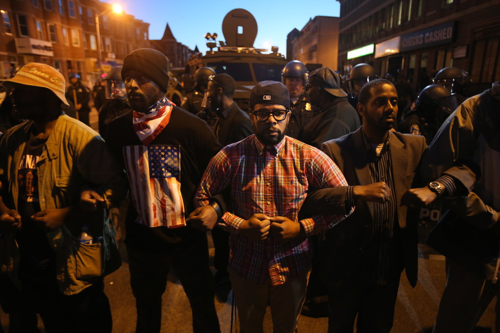 BALTIMORE 4/28/2015 Community members formed a buffer between the police and protesters at dusk, a day after protests over the death of Freddie Gray turned violent. Ruth Fremson/The New York Times