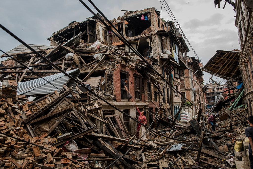 BHAKTAPUR, NEPAL 4/29/2015 Residents retrieved belongings from homes four days after a 7.8 magnitude earthquake rocked the country and left over 9,000 dead. Daniel Berehulak for The New York Times