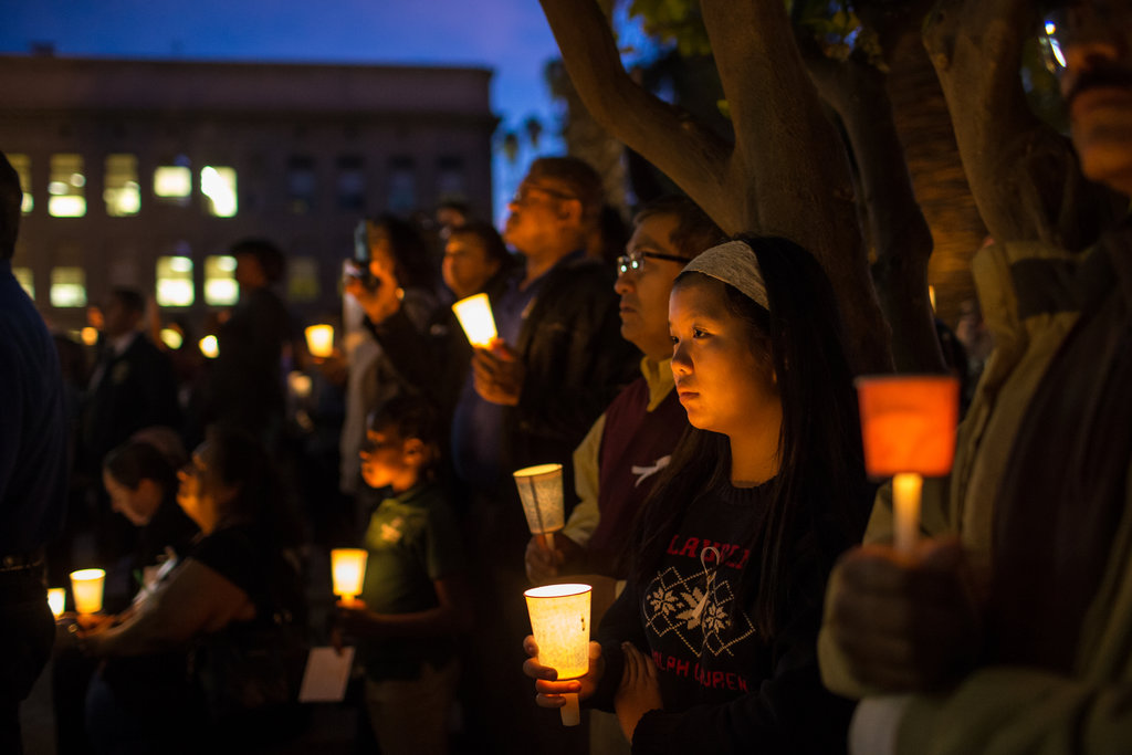 SAN BERNARDINO, CALIF. 12/7/2015 A candlelight vigil commemorated the 14 victims of a mass shooting by a radicalized Muslim couple. Monica Almeida/The New York Times