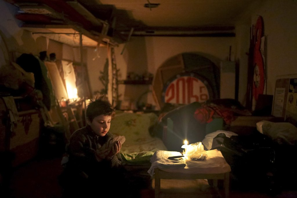 MIRONOVKA VILLAGE, NEAR DEBALTSEVE, UKRAINE 2/17/2015 A child played cards in the local Palace of Culture, used as a bomb shelter during fighting between the Ukrainian Army and Russian-backed militants. Anastasia Vlasova/European Pressphoto Agency