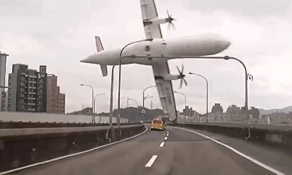 TAIPEI, TAIWAN 2/4/2015 A picture from a video of a TransAsia Airways plane as it struck an elevated highway before plunging into a river, killing 43 people. TVBS Taiwan, via Agence France-Presse — Getty Images