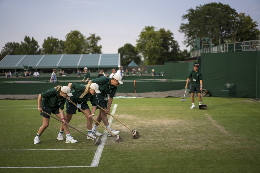 WIMBLEDON, ENGLAND 7/1/2015 A grounds crew tended to a court at the end of play at Wimbledon. Andrew Testa for The New York Times