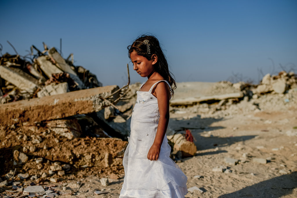 KHUZA'A, GAZA 7/31/2015 Tukka Najjar, 5, at her destroyed home. Over 250 members of her extended family moved to trailers after losing homes in the 2014 Israel-Gaza conflict. Tomas Munita for The New York Times