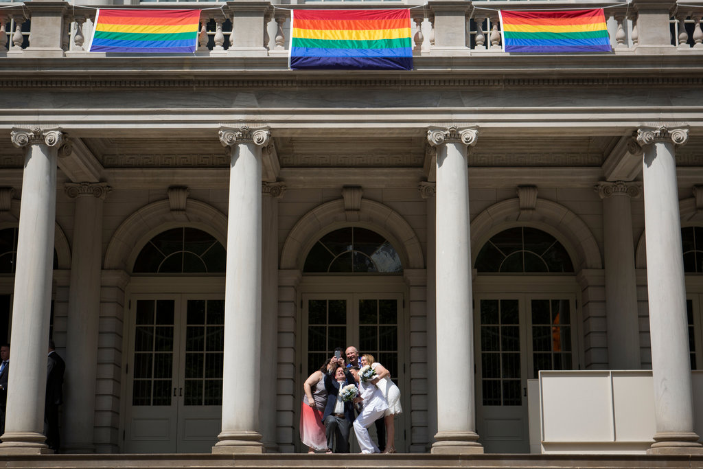MANHATTAN 6/26/2015 Three couples posed on the steps of City Hall on the day the Supreme Court ruled that the Constitution guarantees a right to same-sex marriage. Mark Kauzlarich/The New York Times Share Tweet