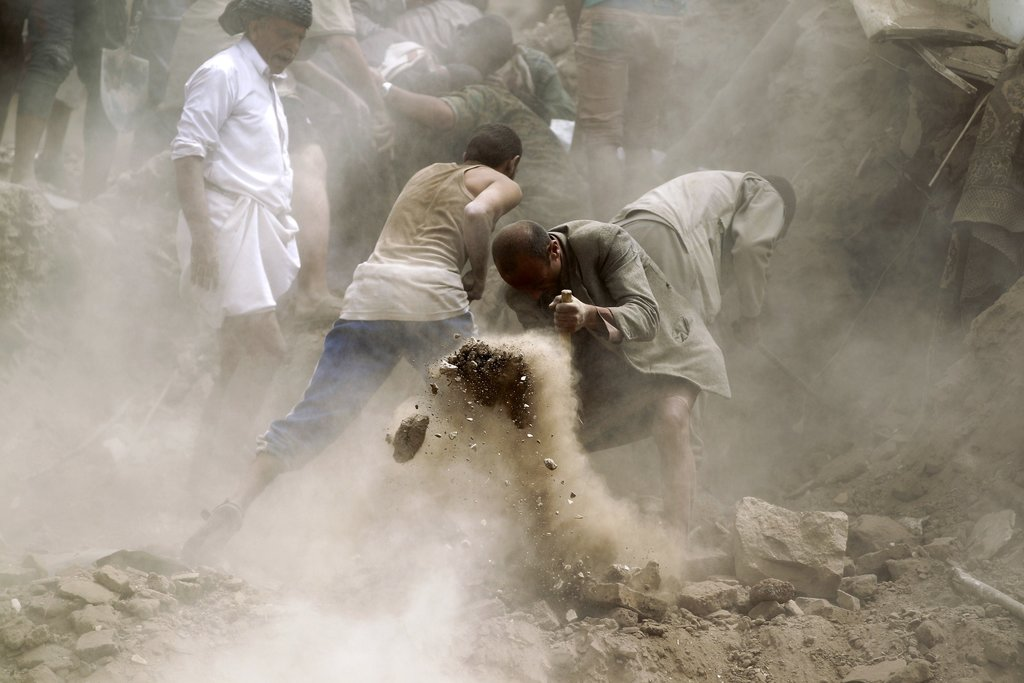 SANA, YEMEN 6/12/2015 Yemenis searched for survivors at a Unesco World Heritage Site after an explosion that witnesses said was caused by Saudi airstrikes. Saudi Arabia denied responsibility. Mohammed Huwais/Agence France-Presse — Getty Images