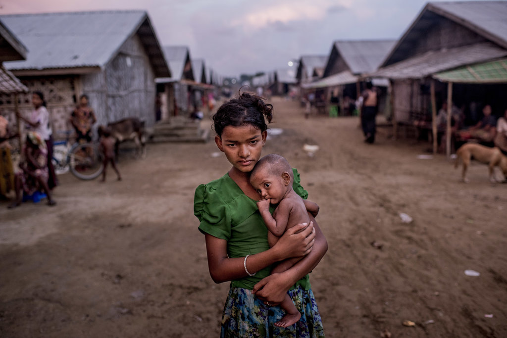 SITTWE, MYANMAR 6/5/2015 A 12-year-old Rohingya girl held her undernourished brother in a squalid camp. Persecution forced thousands of Rohingya to flee the country. Tomas Munita for The New York Times