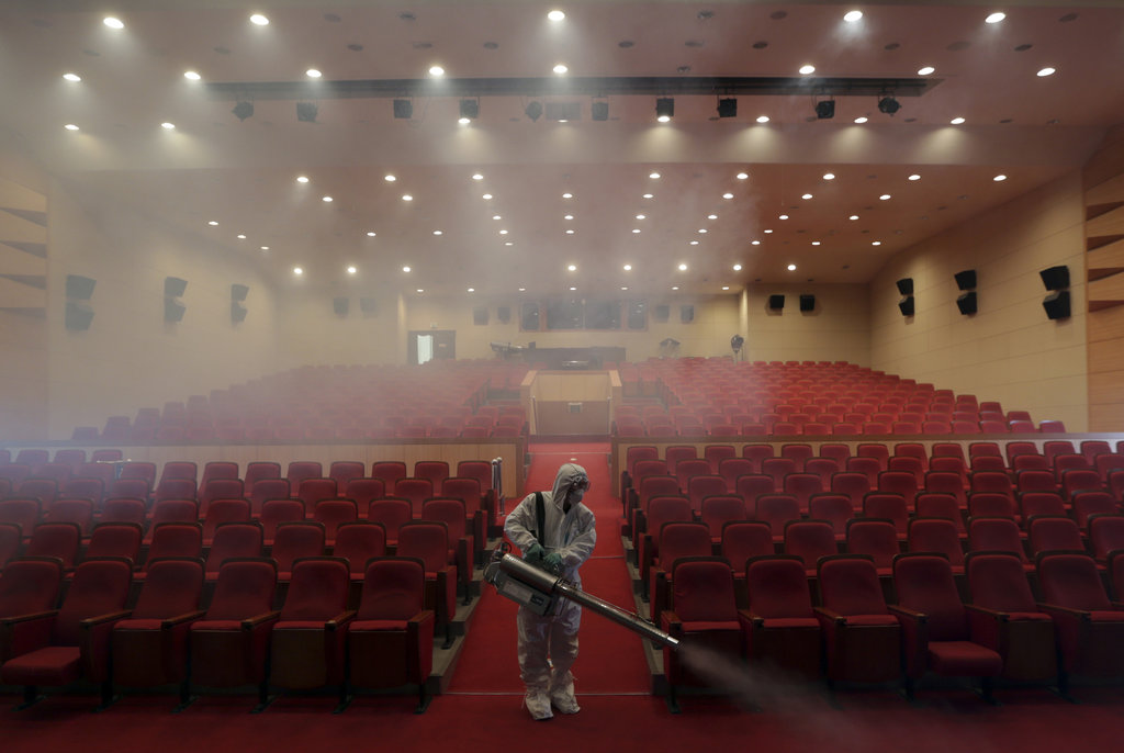 SEOUL, SOUTH KOREA 6/12/2015 A worker sprayed an art hall to fight the MERS virus. South Korea's outbreak was the largest to date outside the Middle East. Lee Jin-Man/Associated Press