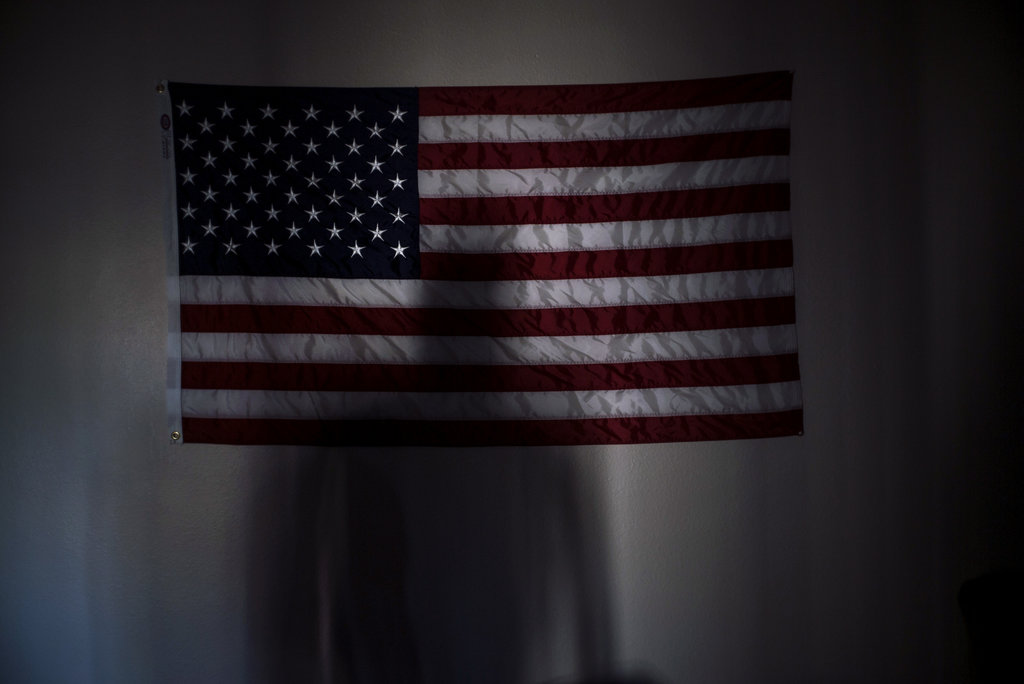 MESA, ARIZ. 3/27/2015 Manny Bojorquez, who served in a hard-hit unit in Afghanistan in 2008, cast a shadow in his apartment. Of about 1,200 Marines in his battalion, at least 13 have committed suicide. Todd Heisler/The New York Times