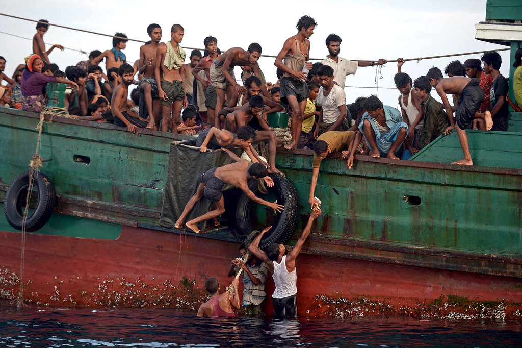 IN THE ANDAMAN SEA OFF THAILAND 5/14/2015 Rohingya migrants on a fishing boat, part of an exodus in which thousands of people took to the sea to flee ethnic persecution in Myanmar. Christophe Archambault/Agence France-Presse