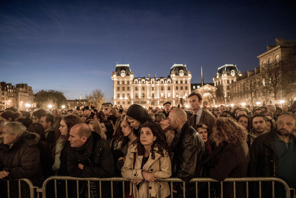 PARIS 11/15/2015 People gathered outside the Notre Dame Cathedral during Mass to commemorate the victims of terrorist attacks that killed 130 people. Tomas Munita for The New York Times Share Tweet