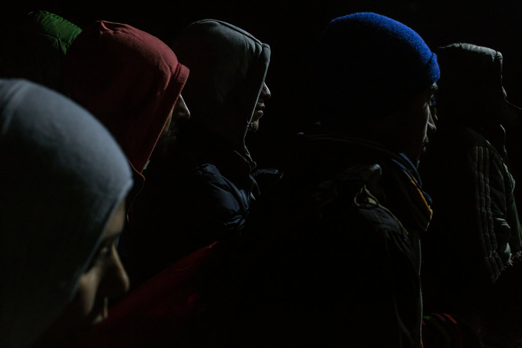 GEVGELIJA, MACEDONIA 11/21/2015 Migrants waiting to enter a registration camp after crossing into Macedonia from the Greek border town of Idomeni.  Mauricio Lima for The New York Times