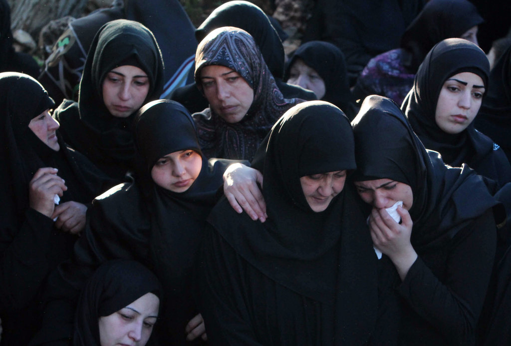 TALLOUSA, LEBANON 11/13/2015 Mourners at a funeral procession for a victim of twin suicide bombings in southern Beirut. The attacks killed at least 43 people and wounded over 200. Mohammed Zaatari/Associated Press