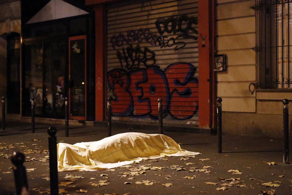 PARIS 11/13/2015 A victim outside the Bataclan theater, where 90 people were killed during coordinated terrorist attacks that left 40 more dead across the city and in a northern suburb. Jerome Delay/Associated Press