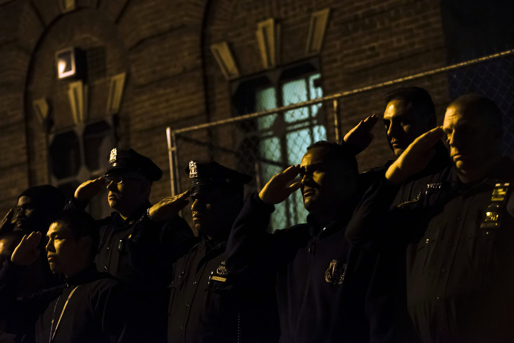 MANHATTAN 10/21/2015 New York City police officers stood at attention as the remains of Officer Randolph Holder, who was killed on the job, were taken from a Harlem hospital.   Karsten Moran for The New York Times