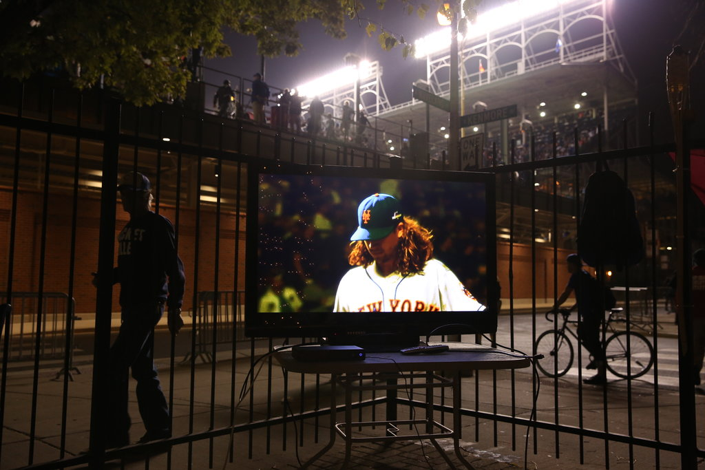 CHICAGO 10/20/2015 Mets pitcher Jacob deGrom, on a television outside Wrigley Field during the National League Championship Series versus the Cubs. The Mets swept the Cubs, then lost the World Series to Kansas City. Todd Heisler/The New York Times