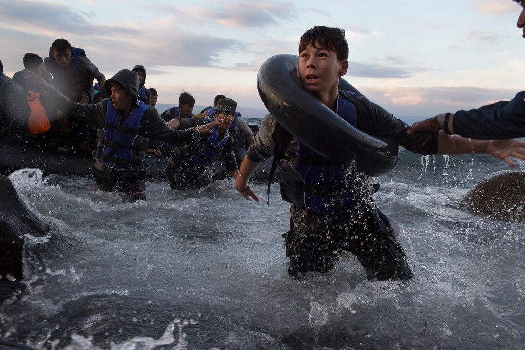 LESBOS, GREECE 10/1/2015 Migrants reached the Greek shore after traveling from Turkey on a rubber raft through high winds and rough seas. Tyler Hicks/The New York Times Share Tweet