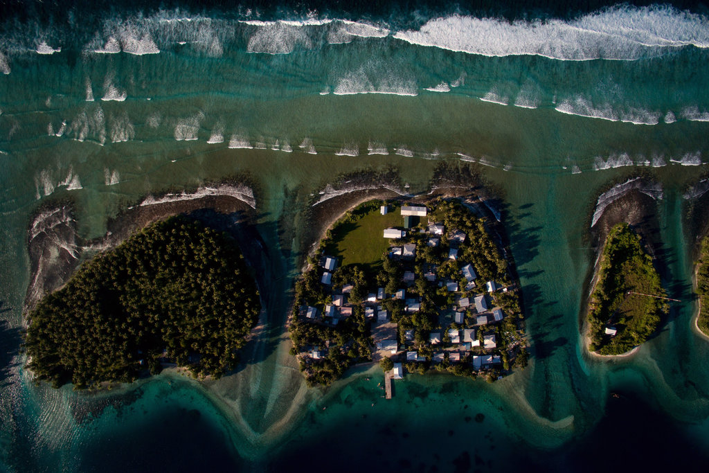 MARSHALL ISLANDS 10/29/2015 The islet of Ejit (center), which is under threat from rising seas. Most of the South Pacific nation's 1,000 islands are less than six feet above sea level. Josh Haner/The New York Times