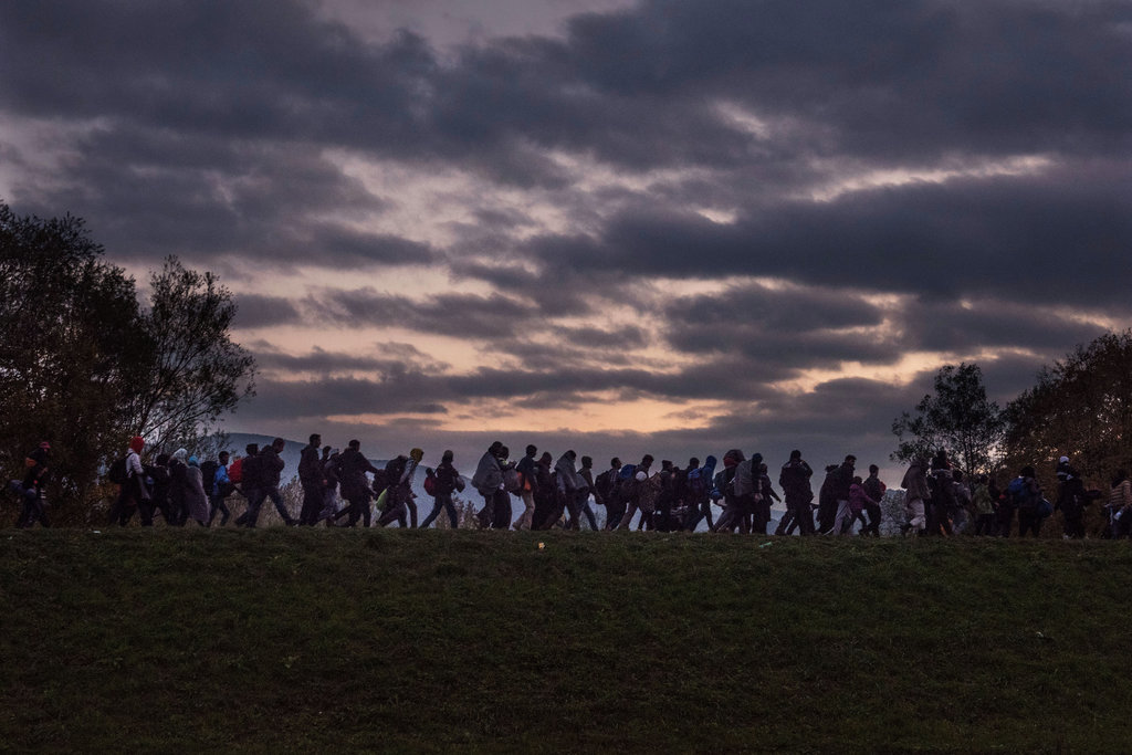 DOBOVA, SLOVENIA 10/23/2015 Asylum seekers on the way to a Slovenian registration camp. The nation was flooded with thousands of refugees. Sergey Ponomarev for The New York Times