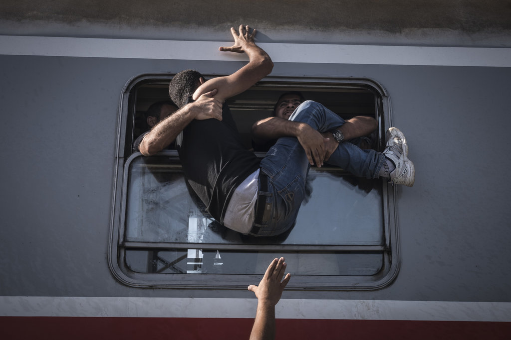TOVARNIK, CROATIA 9/18/2015 People struggled to climb onto a train headed to Zagreb, the Croatian capital. Key European nations tightened their borders to control the tide of refugees. Sergey Ponomarev for The New York Times
