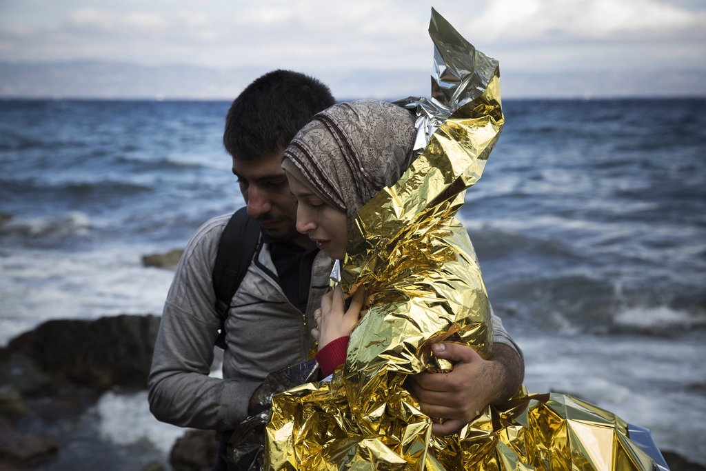 LESBOS, GREECE 9/30/2015 A Syrian couple arrived on a Greek island after traveling from Turkey's coast on a dinghy, a common route for migrants heading to Europe. Santi Palacios/Associated Press