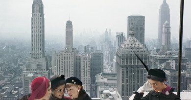 Fashion models wear a variety of hats on the roof of the Conde Nast Building against a view of the New York skyline for Vogue, 1949, Manhattan, New York City.