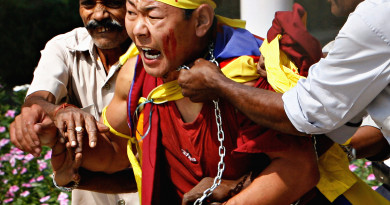 RNPS IMAGES OF THE YEAR 2007 - A Tibetan exile is led out by guards from inside the Chinese Embassy compound in New Delhi October 10, 2007. A group of Tibetan exiles entered the embassy in protest against China's new religious measures on reincarnation. REUTERS/Desmond Boylan (INDIA) - GF2DWSQPQUAA